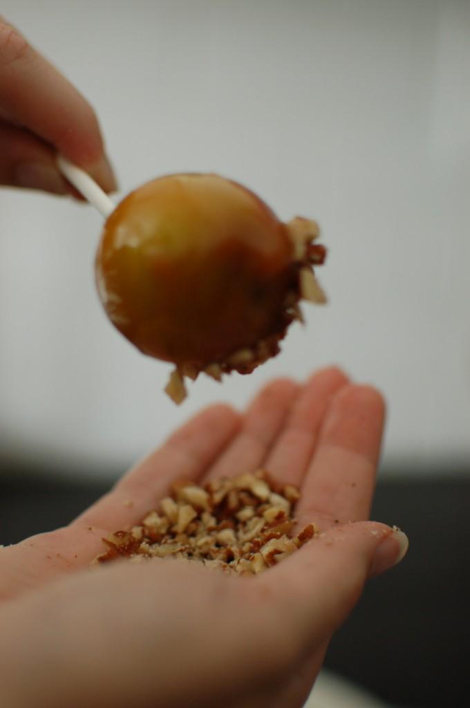 Rolling apple in nuts