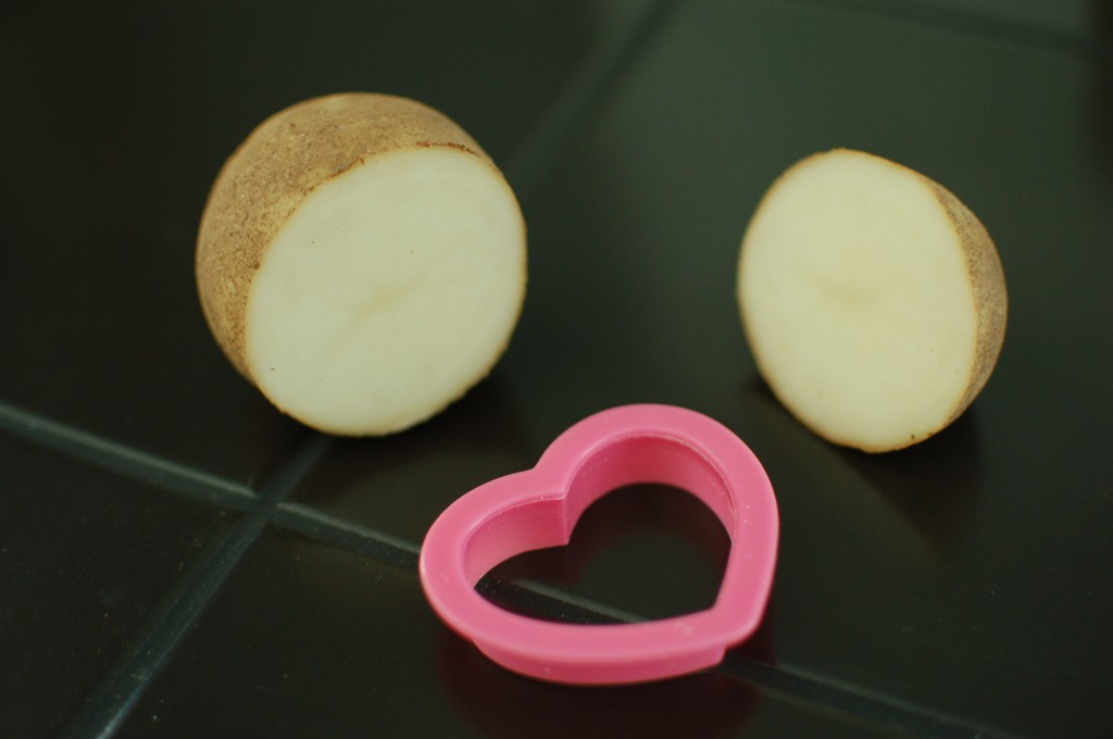Halved potato and cookie cutter