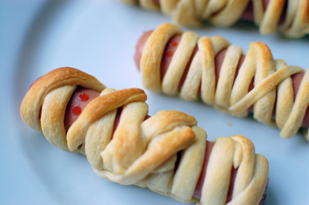 ... by making the perfect October take on hot dogs — hot dog mummies