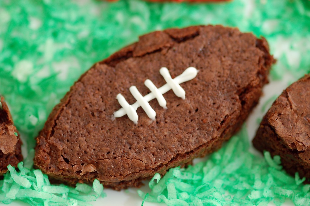 Brownie football with coconut grass