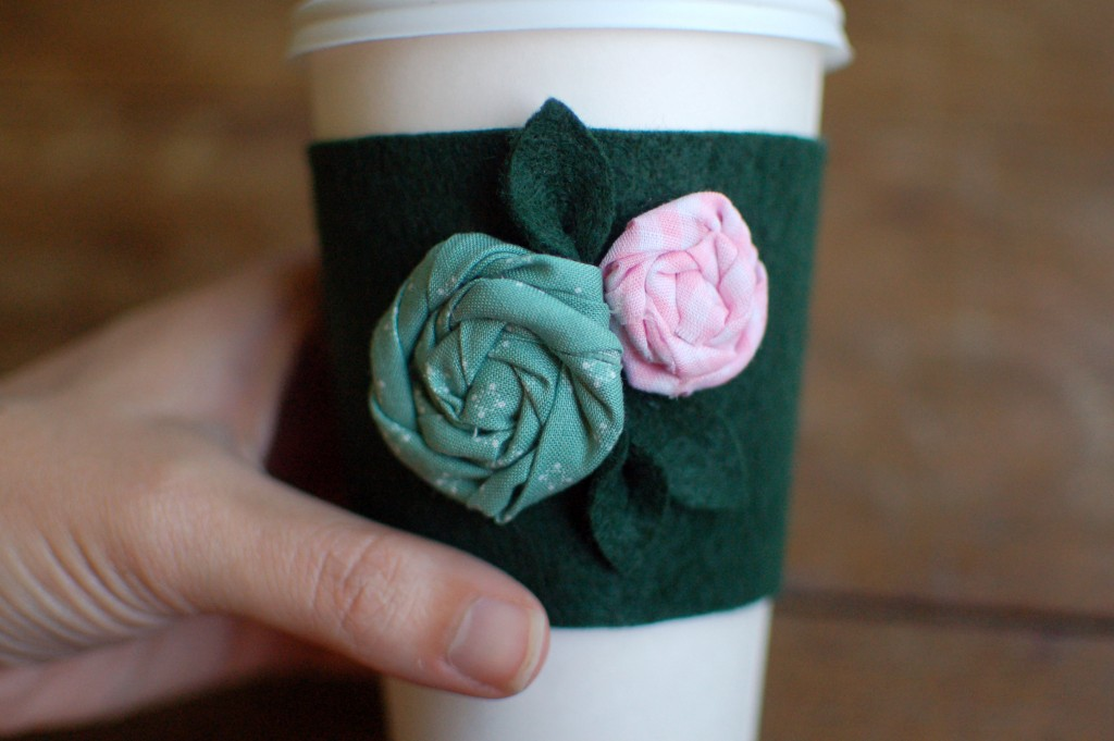 Felt coffee sleeve with flowers