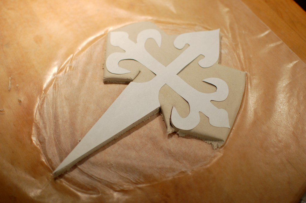 Partially cut out clay cross