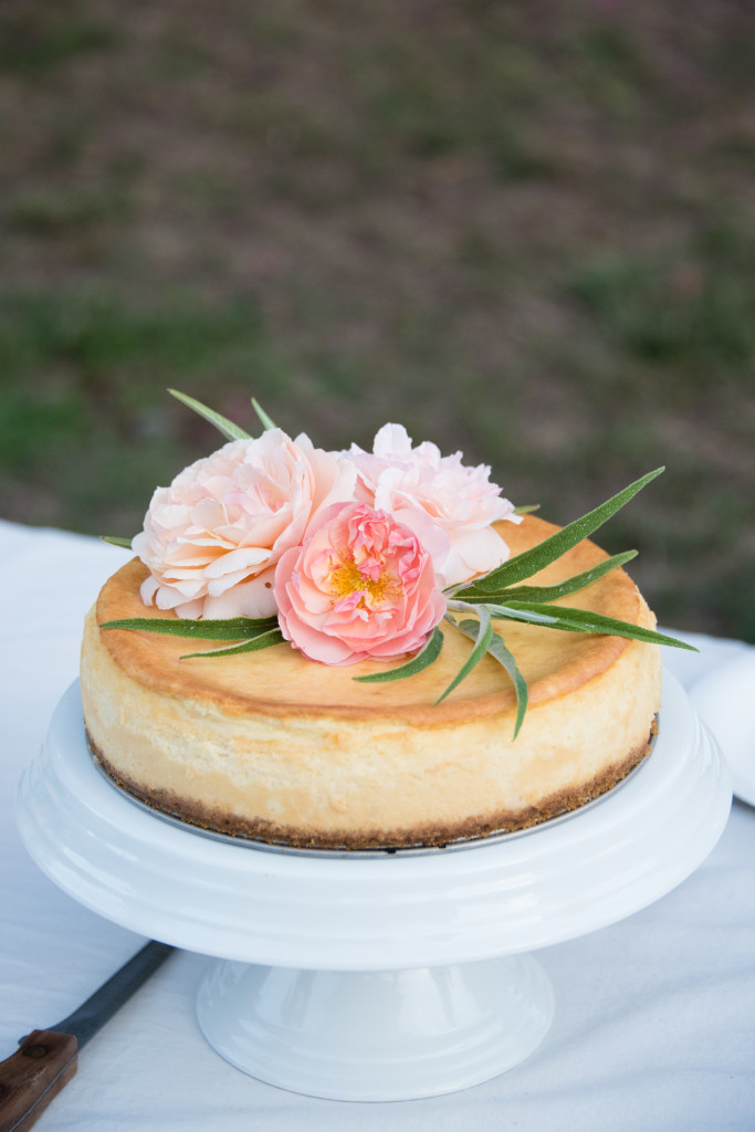 Cheesecake with floral decorations and jam filling